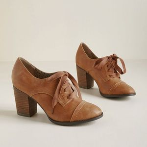 Restricted leather oxford heels.